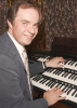 Michael Wooldridge at his custom built 3-manual Roland Atelier